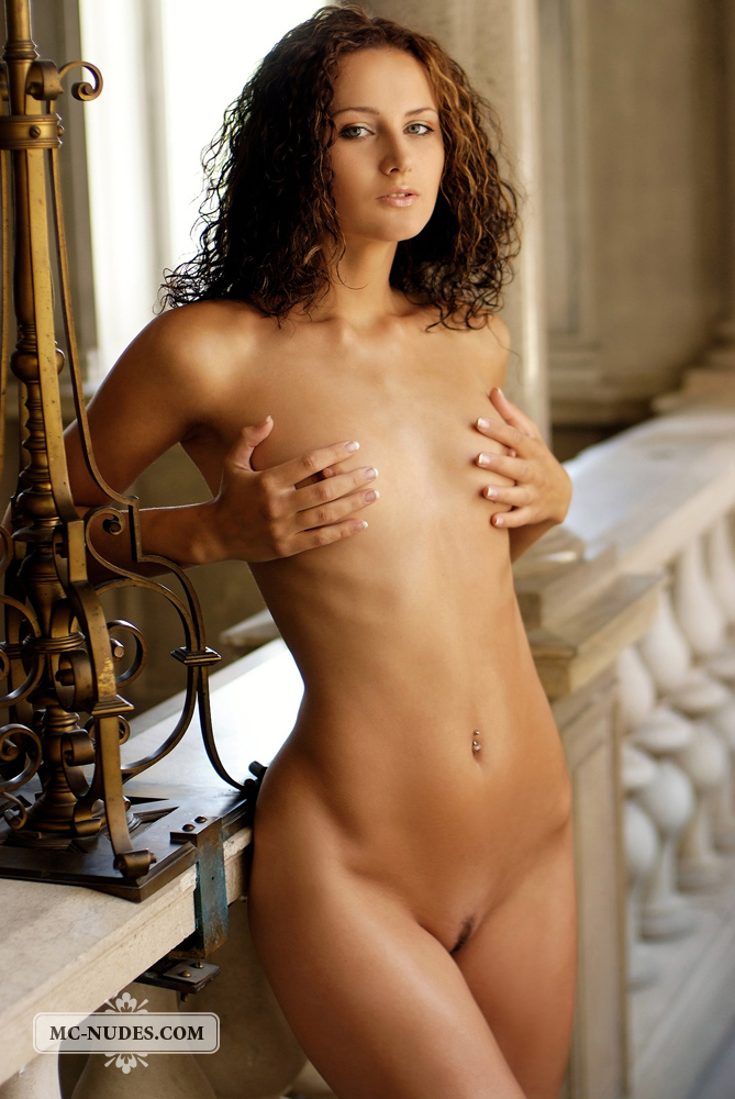 Sexy curly brunette naked